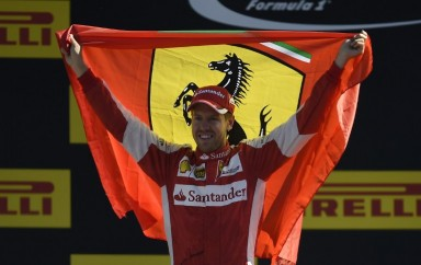 Ferrari's German driver Sebastian Vettel celebrates on the podium placing second in the Italian Formula One Grand Prix at the Autodromo Nazionale circuit in Monza on September 6, 2015. AFP PHOTO / OLIVIER MORIN